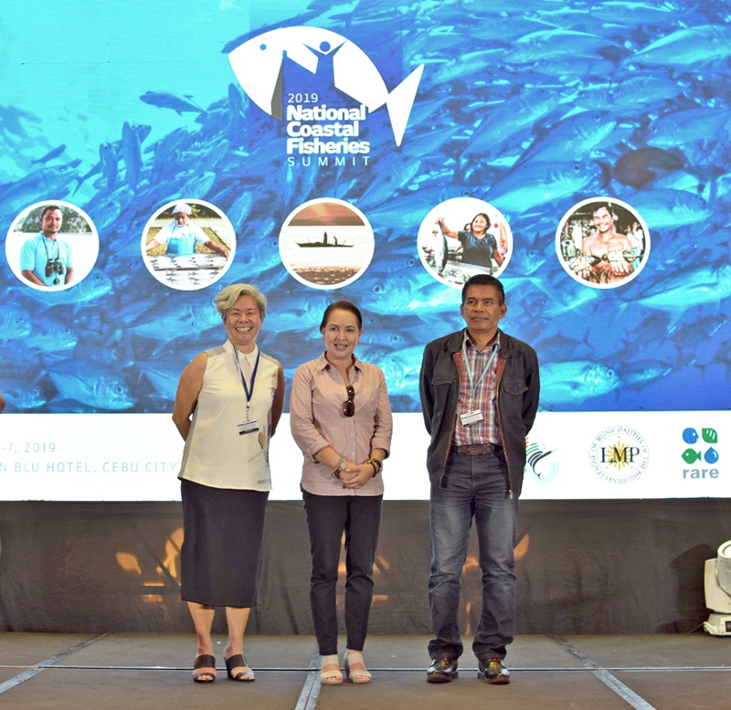 Rare Philippines Vice President Rocky Sanchez Tirona (left) is joined on stage by LMP Mayor Maria Fe Brondial (middle) of Socorro, Oriental Mindoro, and DA-BFAR Undersecretary for Fisheries Eduardo Gongona (right)