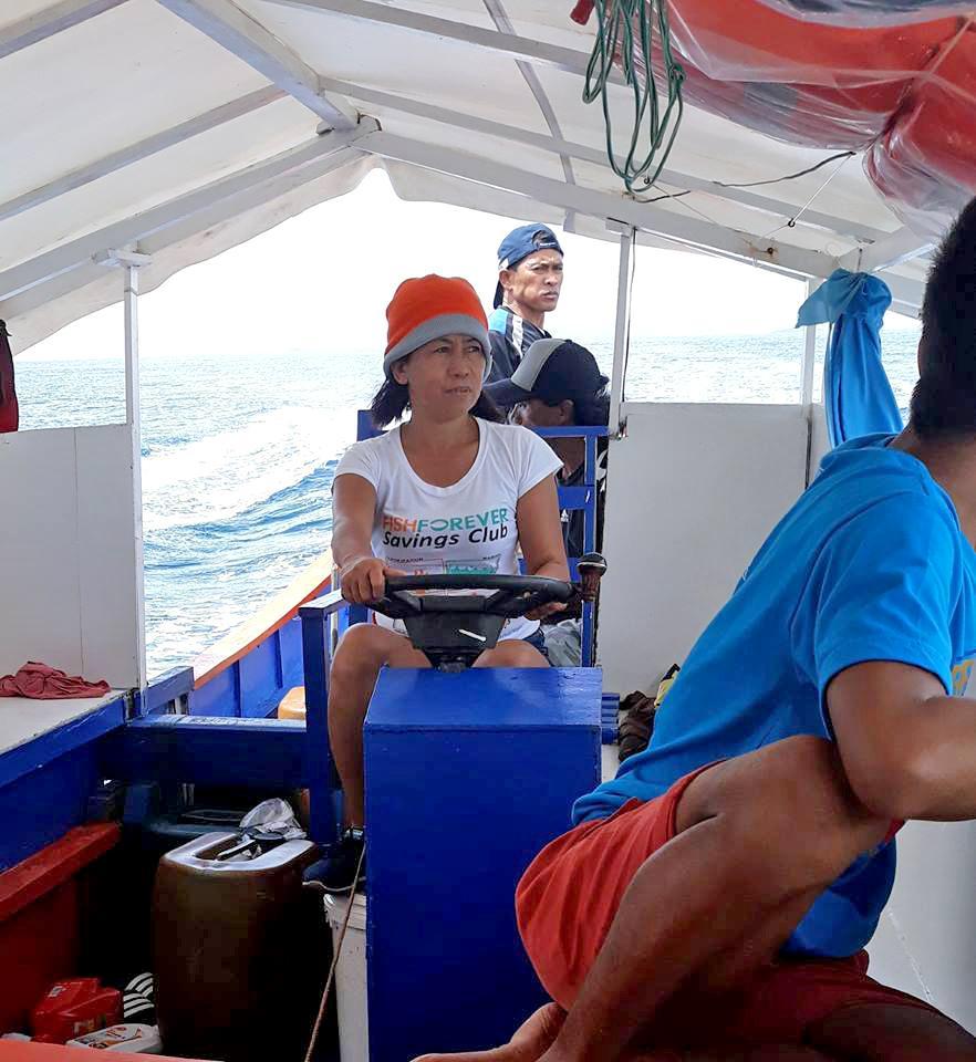 Gina Barquliia on a boat