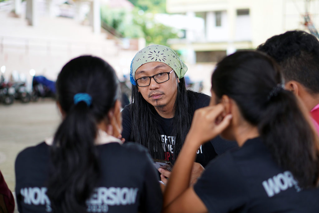 Artist AG Sano with students.