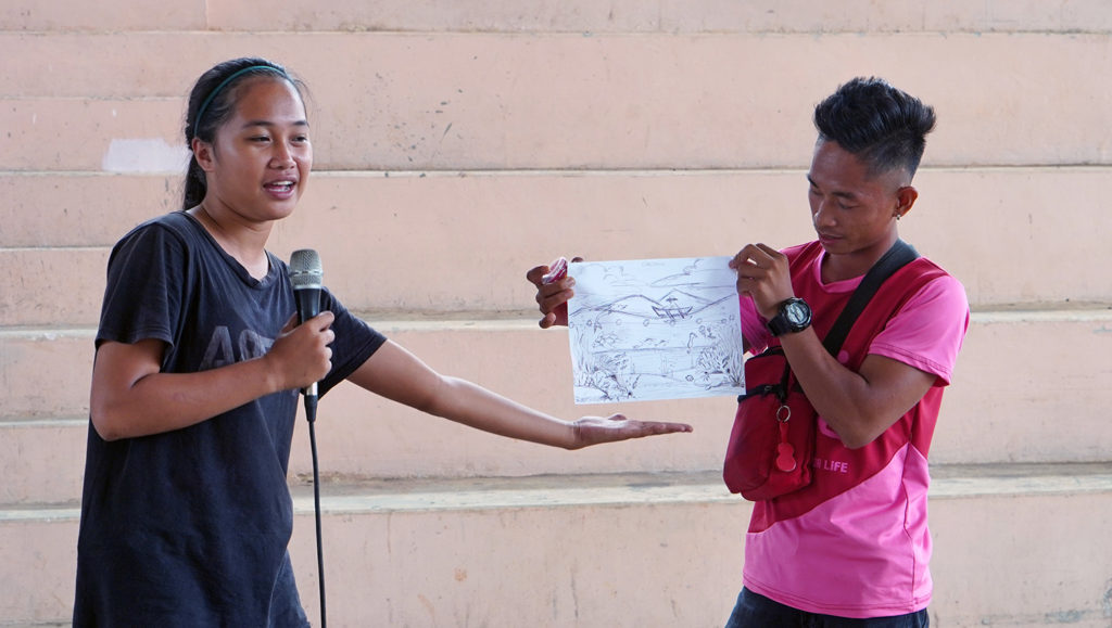 Youth presenting a mural sketch.