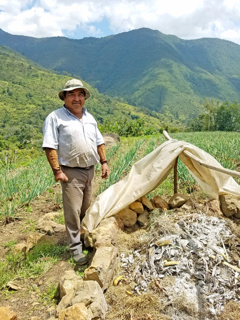 Local farmer, Don José Valencia, and his compost pile in El Moral, Valle del Cauca.