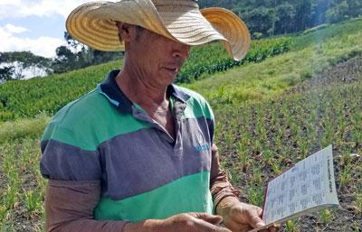 Colombian farmer reading soil card