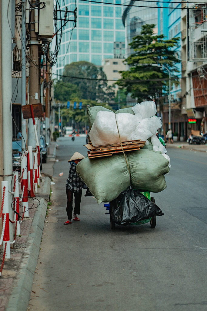 Man pushing a cart in the streets of Ho Chi Minh City, Vietnam.