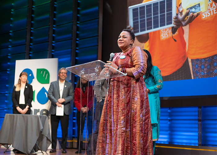 Fatma from Solar Sister acceptin Solution Search award