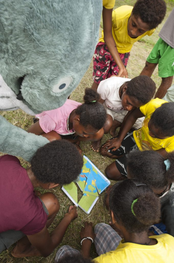 Mascot playing games with children in Bogor, Indonesia.