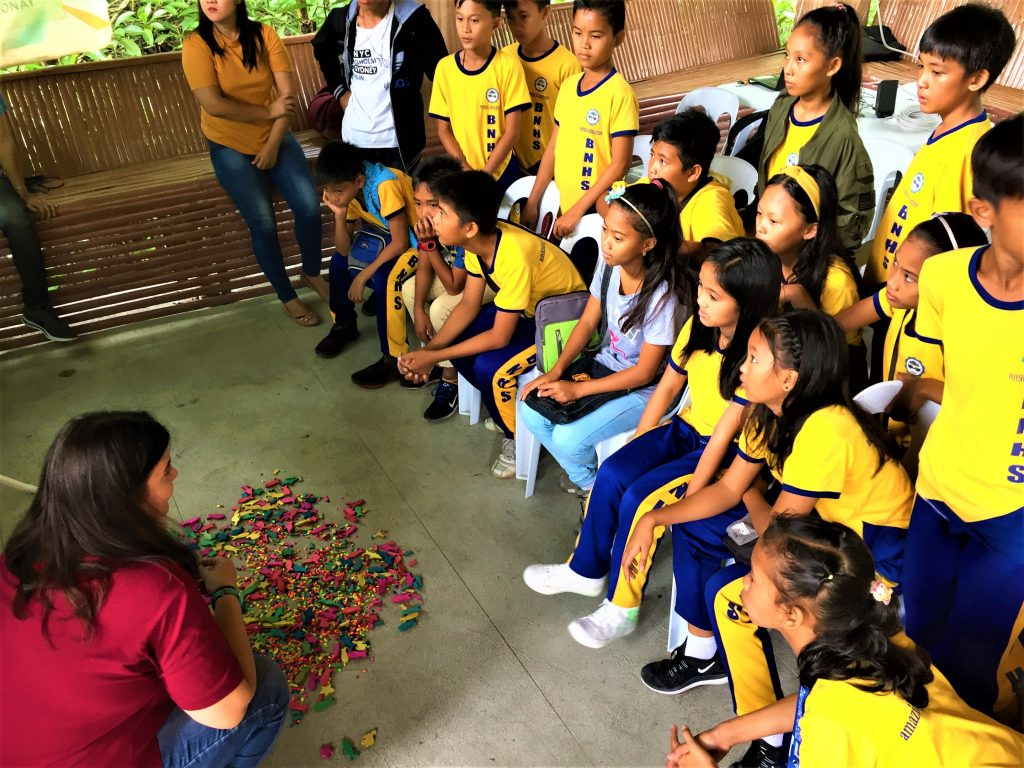 Holly Ziemer plays the Fish Game with some students in Calapan, Oriental Mindoro.