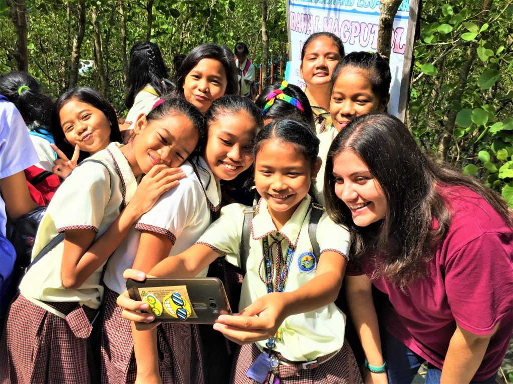 Holly Ziemer and Grade 7 students in Calapan in Oriental Mindoro during Environmental Awareness Time (EAT), which aims to educate over 500 students about the importance of ecosystem stewardship and sustainable fisheries practices.