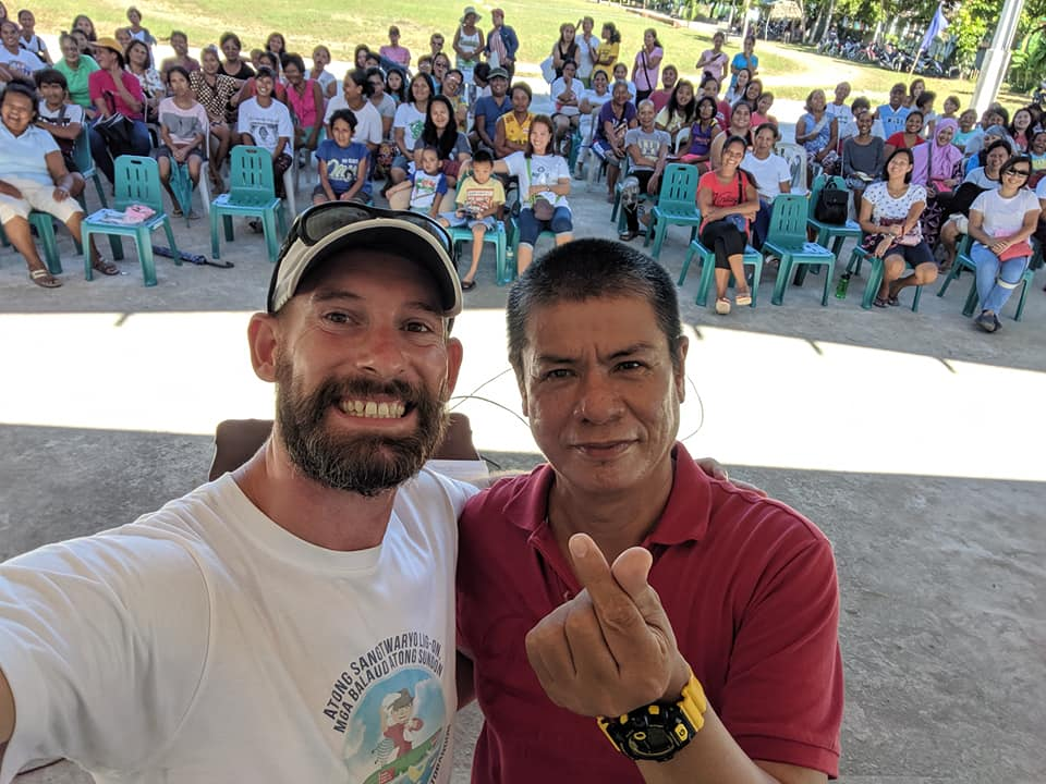 Scott McGuire hams it up with Principal Esmeraldo Pamaos at the Mahayahay Elementary School in Saint Bernard, Southern Leyte during an orientation on Proper Waste Disposal for students.