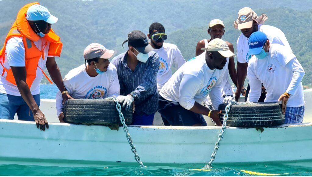 Rare, Centro de Estudios Marinos, and local and national government staff install buoys in coastal waters of Honduras.